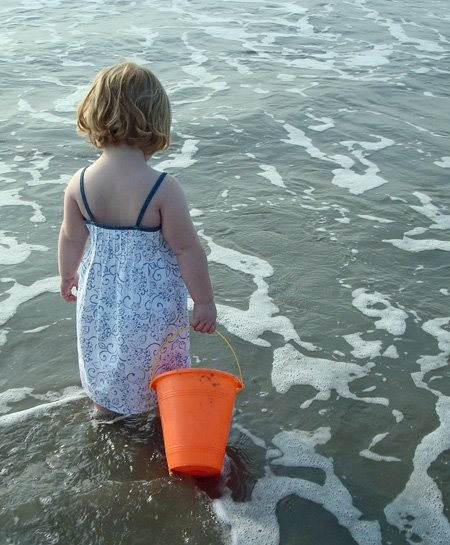 My daughter at the shore.