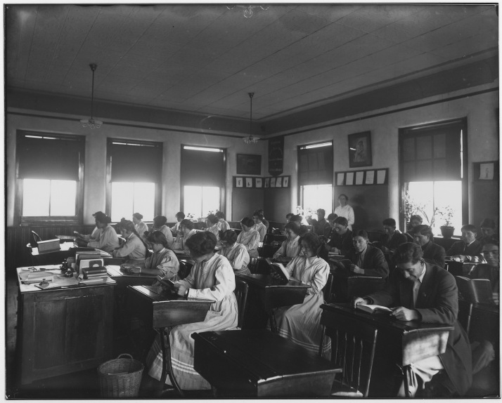 Miss Robertson's School Room (1913). Public Domain photo. National Archives Bureau of Indian Affairs.