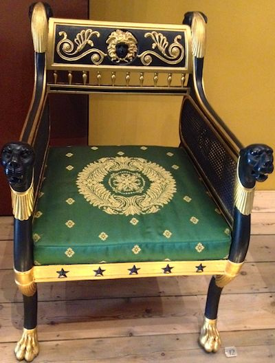 An elaborate green chair. Perhaps fit for a duke?