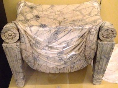 A marble stool. Beautiful - but I can't imagine it being comfy
