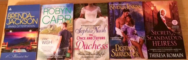 Free book swag from the Popular Romance Project conference.