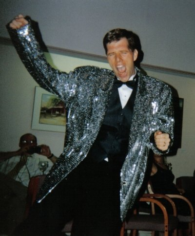 My husband channeling Elvis at our wedding reception.