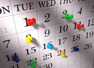 Close up , colorful pushpins on calendar