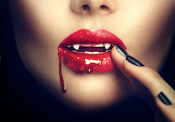 Halloween. Sexy vampire woman lips with blood