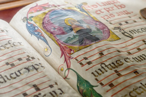 Medieval ancient illuminated manuscript with gregorian chant music